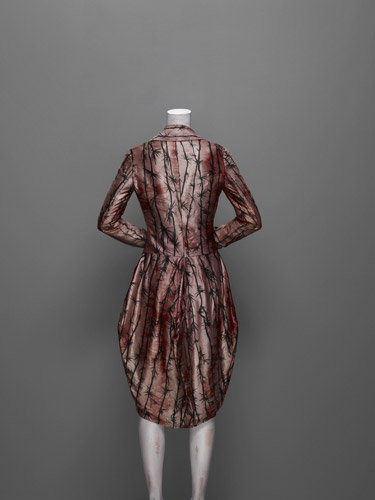 alexander mcqueen  1st collection 1992 coat with hair from metsueum.org McQ.3018.L