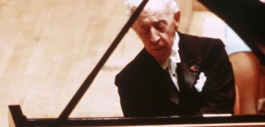 Arthur Rubinstein performing on the piano