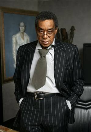 don cornelius, older, black, pinstripe suit